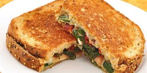 spinach-prosciutto-stuffed-grilled-cheese